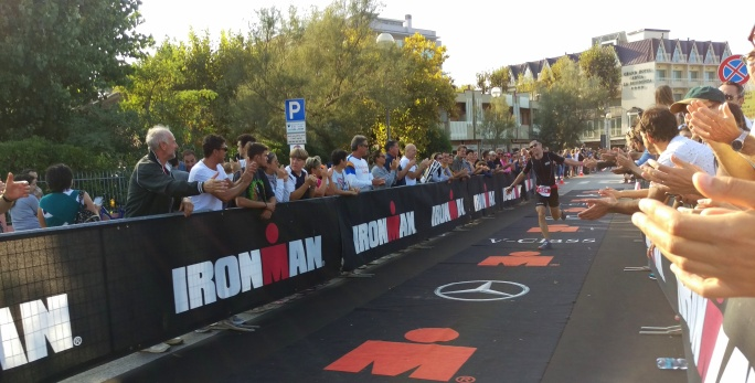 My boy doing a helicopter down the carpet to secure #2 AG 40-44 in ironman Cervia, Emilia Romagna, Italy